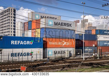 Container Terminal And Logistics Center In Moscow. Stacked Cargo Containers Waiting For Loading And