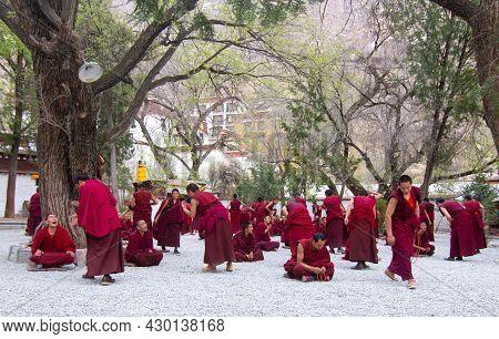 Lhasa Tibet China:15apr2016 The Debates Among Tibetan Monks On The Tibetan Buddhism In Sera Monaster