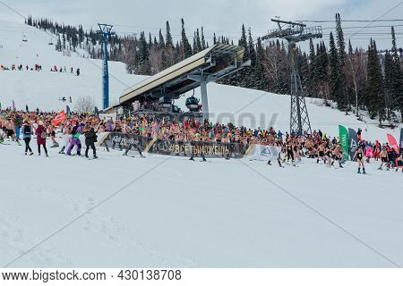 Grelka Fest Is A Sports And Entertainment Activity For Ski And Snowboard Riders In Bikini. Crowd Of