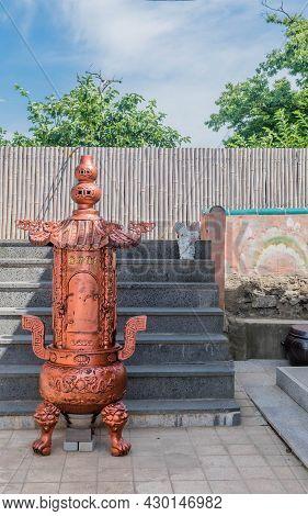 Bronze Gilded Steel Incinerator At Seaside Temple.