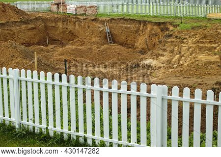 Neighbours Fence And Foundation Ditch, Daytme Shot Without People