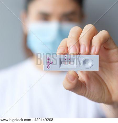 Woman Holding Rapid Antigen Test Kit With Positive Result During Swab Covid-19 Testing. Coronavirus
