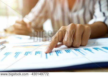 Close Up Image, Business Female Pointing Finger On Financial Data Papers