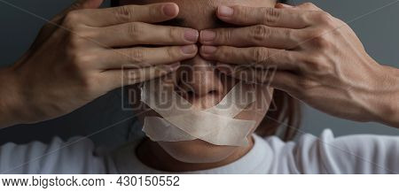 Woman With Mouth Sealed In Adhesive Tape. Free Of Speech, Freedom Of Press, Human Rights, Protest Di