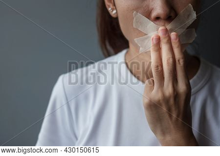 Woman Show Three Finger With Mouth Sealed In Adhesive Tape. Freedom Of Speech, Human Rights, Protest