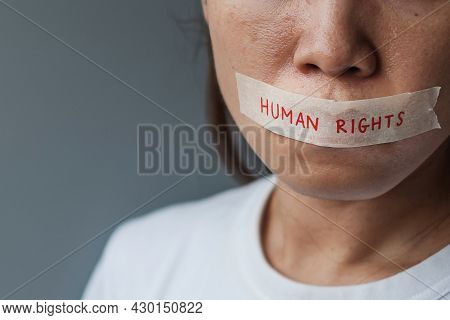 Woman With Mouth Sealed In Adhesive Tape With Human Rights Message. Free Of Speech, Freedom Of Press
