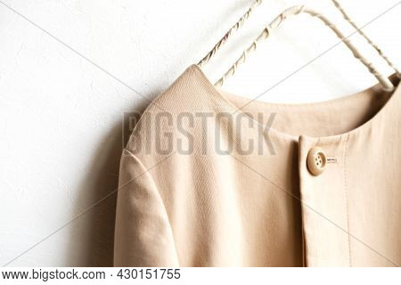 A Simple Beige Trench Coat Or Jacket Isolated Over White And Close Up.