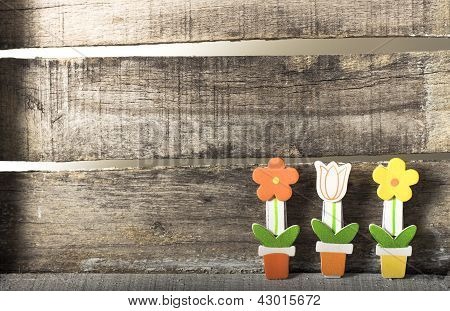 Flowers In A Pot On Wooden Background