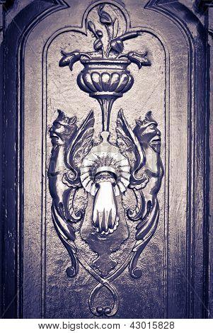 Figures carved door, with knocker, black & white