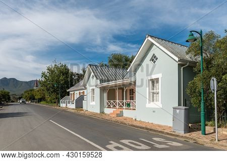 Stanford, South Africa - April 12, 2021: A Street Scene, With Historic Houses, In Stanford In The We