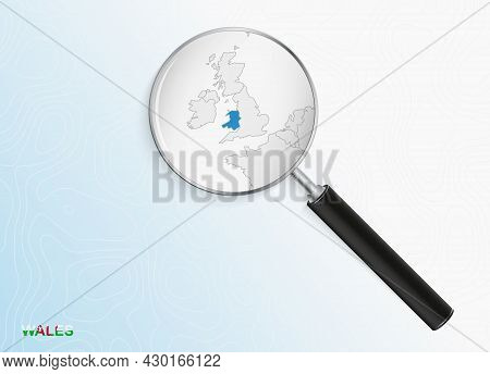 Magnifier With Map Of Wales On Abstract Topographic Background. Vector Map.