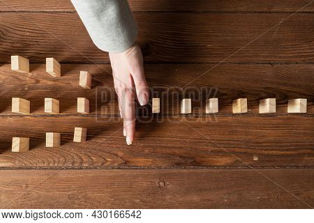 Business Woman Hand Stop Domino Effect. Operative Business Solution, Strategy And Successful Interve
