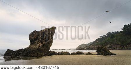 Panoramic View Of Playa Del Aguilar At Low Tide At Sunset In Asturias In Spain.