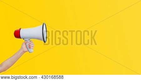 Business Communication And Marketing Concept : Female Hand Holding Megaphone For Announcement And Ad