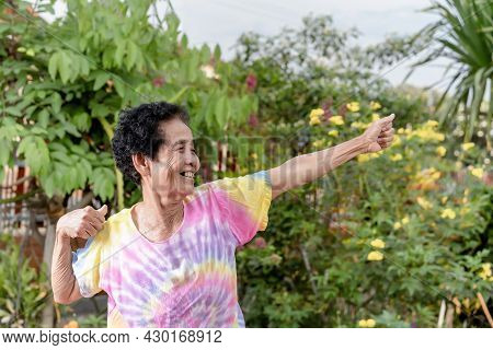 Old Asian Woman Face With Wrinkle Elderly Senior Smiling Happiness With A Few Broken Teeth. Happy Ag