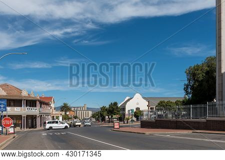 Caledon, South Africa - April 12, 2021: A Street Scene, With Buildings And Vehicles, In Caledon In T