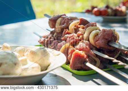Raw Meat With Vegetables On A Skewer, Ready To Grill.