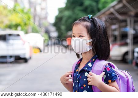 Girl Wearing 3d Hygienic Face Mask And Carrying Purple School Bag Is Preparing To Go Back To School
