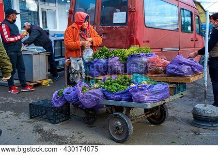 A Street Vendor Sells Fresh Lettuce From A Cart On The Street. Tbilisi, Georgia - 03.19.2021