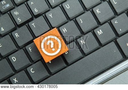 Laptop Keyboard, Colored Cubes With Query Icons. Question Mark Concept