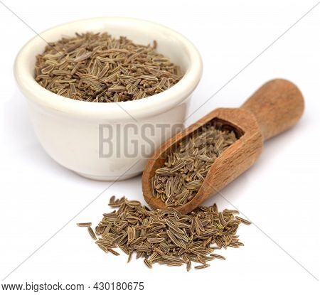 Cumin Seeds Whole In A Bowl And Scoop Over White