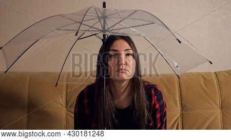 Upset Brunette Lady Hides From Water Flowing From Upstairs Neighbors Under Transparent Umbrella Sitt