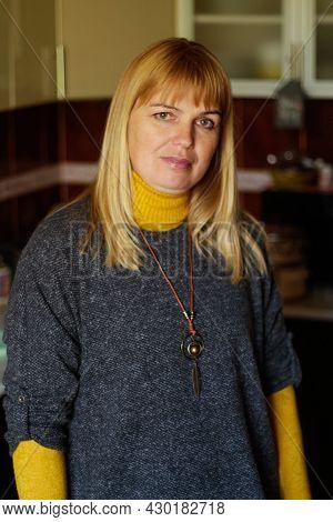 Defocus Middle Blond 40s Woman Standing Indoor At Home In Kitchen. Happy Beautiful Lady. Women Weari