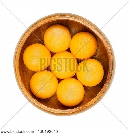 Honey Cantaloupe Melon Balls In A Wooden Bowl. Freshly Cut Out With A Melon Baller, Ready-to-eat Swe