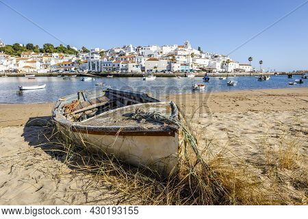 Cityscape Of Ferragudo With Boats In The Foreground, Algarve, Portugal