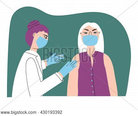 A Doctor Or Nurse Gives A Flu Or Covid-19 Injection To A Patient. Coronavirus Infection Vaccination