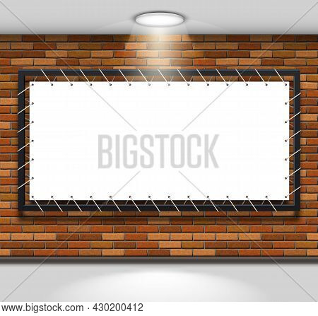 Stretch Fabric Banner In A Metal Frame On A Brick Wall Illuminated By A Ceiling Lamp. Mockup With Em