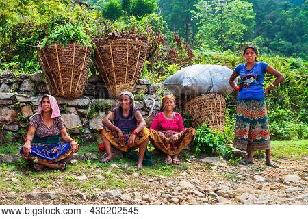 Pokhara, Nepal - May 26, 2012: Unidentified Nepalese Women Farmers Have A Rest After Working In A Ri