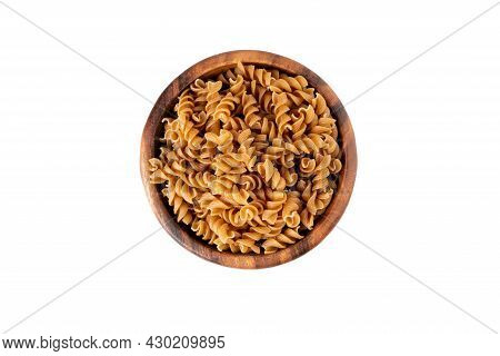 Bowl Of Wholegrain Pasta Spirals Or Fusilli, Isolated On White Background. Copy Space