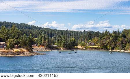 Panoramic View Of A Cosy Homes On The Rocky Coast During A Sunny Summer Day. Taken On Galiano Island