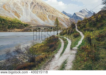 Scenic Mountain Landscape With Footpath Along Water Streams In Motley Autumn Valley. Colorful Autumn