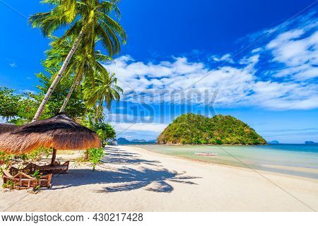 Beach With White Sand, Coconut Palms And Turquoise Water In El Nido Province, Palawan Island In Phil