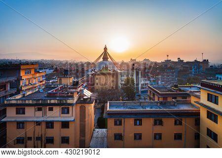 Boudhanath Great Stupa And Kathmandu City Skyline In Nepal At Sunset