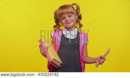 Cheerful Funny Teenage Schoolgirl Kid With Books Dressed In Uniform Wears Pink Backpack Smiling, Loo