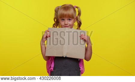 Smiling Schoolgirl Wears Backpack, Hiding Behind A Book, Laugh Fooling Around Showing Tongue Making