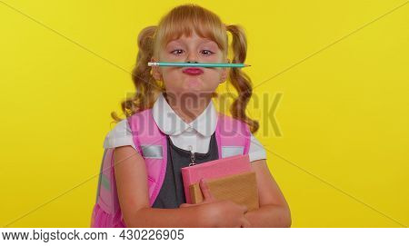 Funny Joyful Kid Primary School Girl With Ponytails Wearing Uniform Making Playful Silly Facial Expr