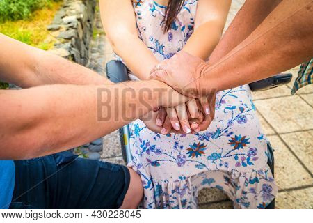 Caregiver, Specialized Assistance, Carer Hands Holding Hands Of Diabled Woman In Wheelchair. Philant