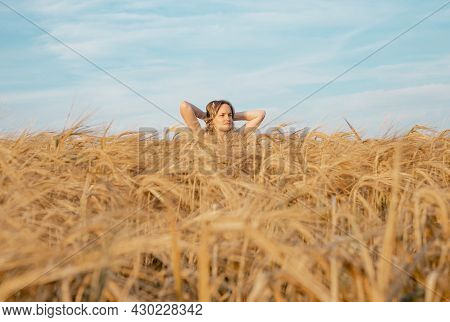 Young Tranquil Woman Inside Gold Wheat Field In Summer, Meditating In Nature.
