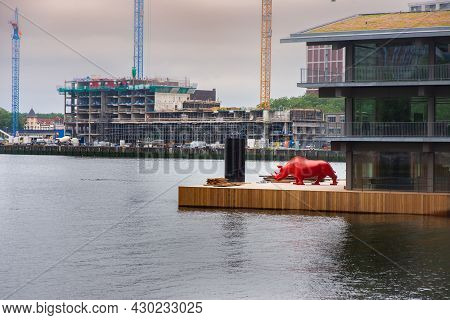29 June 2021 Rotterdam; The Netherlands; Red Rhino And Modern Architecture In The Port Of  Rotterdam