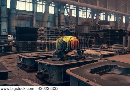 Worker With Molds For Metal Cast In Metallurgical Plant Foundry. Heavy Industry.
