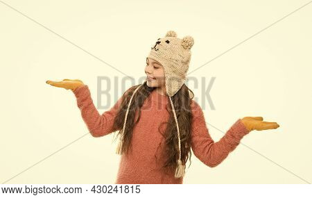 Happy Childhood Activity. Little Girl In Earflap Hat Funny Pattern. Winter Holiday Wonder. Child Kni