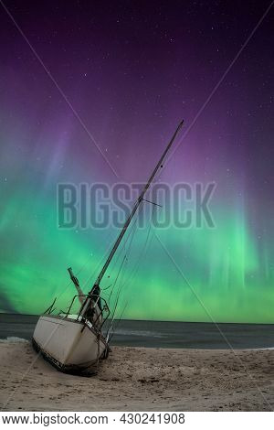 Aurora Borealis Over A Shipwreck Off The Coast Of Uttakleiv Beach In Norway