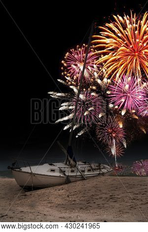 Fireworks In The Night Sky Over A Shipwreck Off The Coast Of Clam Pass In Naples, Florida