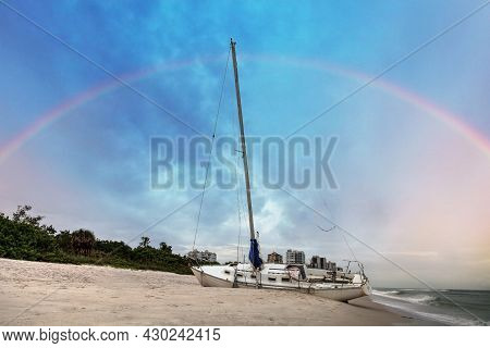 Rainbow Over A Shipwreck Off The Coast Of Clam Pass In Naples, Florida