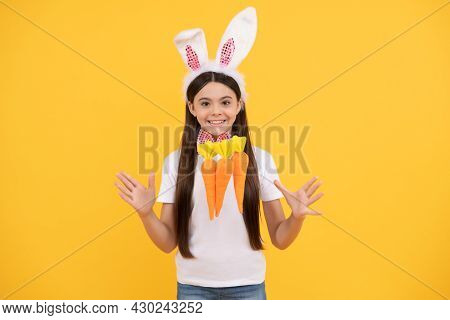 Happy Easter Child Girl In Bunny Ears And Bow Tie Hold Carrot, Happy Easter