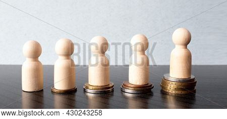 Wooden Figurine On Top Of Stairway. Business Concept